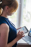 woman working with the tablet Stock Images