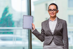 The woman working with tablet in office Royalty Free Stock Photo