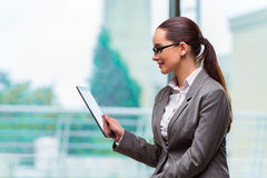 The woman working with tablet in office. Woman working with tablet in office Stock Photo
