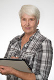 Woman working with tablet pc Stock Photos