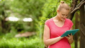 Woman working with tablet PC outdoor stock video footage