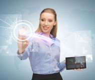 Woman working with tablet pc and virtual screen Stock Photo
