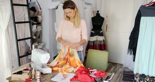 Woman working in tailor`s shop stock footage