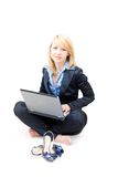 Woman working take off shoes. Woman working on a laptop and take off shoes Royalty Free Stock Images