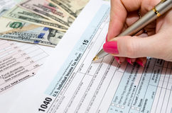 Woman working with tax form documents with money Stock Photo