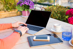 Woman working with tech gadgets outdoors. Woman working with gadgets outdoors Royalty Free Stock Images