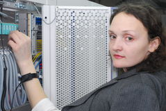 Woman working on telecommunication equipment Royalty Free Stock Photos