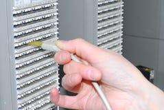 Woman working on telecommunication equipment Stock Photo