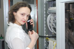Woman working on telecommunication equipment Stock Photos