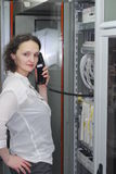 Woman working on telecommunication equipment Royalty Free Stock Images