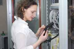 Woman working on telecommunication equipment Stock Photo