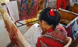 Woman Working on Textile stock photography