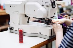Woman working in textile industry Stock Image