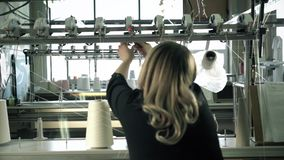 Woman working at thread rewinding machine video stock video