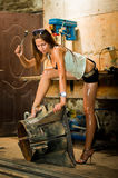 Woman working with tools. Woman in dirty t-shirt working with tools in garage royalty free stock image