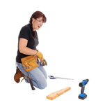 Woman working with tools. A middle age woman kneeling on the floor and working with some tools Stock Images