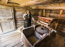 Woman working in a traditional mill. Woman working in a traditional wooden mill, in a remote village, called Eftimie Murgu, in Banat region, Romania. She was Royalty Free Stock Images