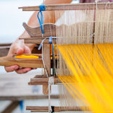 Woman working at traditional Thai loom Royalty Free Stock Image