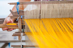 Woman working at traditional Thai loom Stock Photos