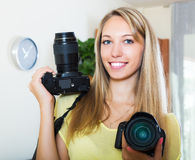 Woman working with two photocameras Royalty Free Stock Photography