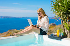 Woman working while on vacation in Mediterranean Stock Photos