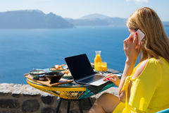 Woman working while on vacation in Mediterranean Royalty Free Stock Image