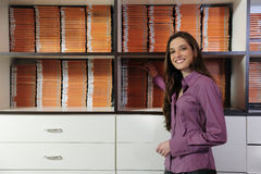 Woman working at the video rental store Stock Image