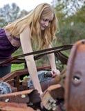 Woman working on vinatge truck stock photo