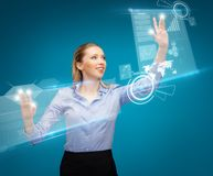Woman working with virtual screens Stock Photography