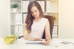 Woman working and waiting for her lunch break Stock Photos