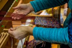 Woman Working in a Weaving Loom, In a Workshop stock images