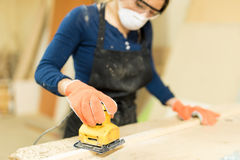 Woman working in a woodshop Stock Photos