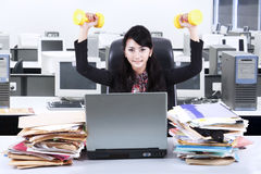 Woman working and workout in office 2 Stock Photo