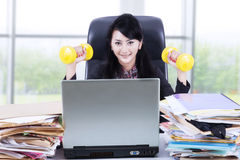 Woman working and workout in office 1 Stock Photos