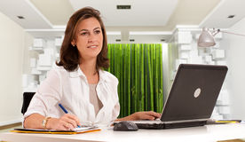 Woman working on a zen environment Royalty Free Stock Photo