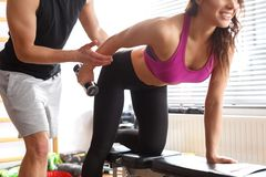 Woman workingout with personal trainer Royalty Free Stock Photos