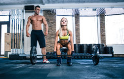 Woman workout with barbell and coach Stock Photos