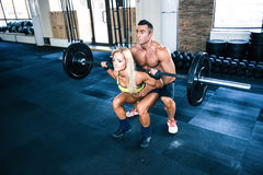 Woman workout with barbell with coach Royalty Free Stock Photos