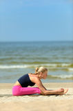 Woman workout on the beach Royalty Free Stock Image