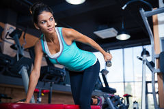 Woman workout with dumbbell on the bench Stock Photo