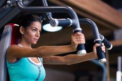 Woman workout on exercises machine Royalty Free Stock Image