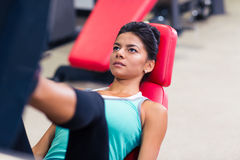 Woman workout on exercises machine Royalty Free Stock Photo