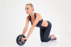 Woman workout with exercises wheel Royalty Free Stock Photos
