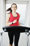 Woman workout  in fitness club on running track Stock Images