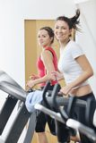 Woman workout in fitness club on running track royalty free stock photos