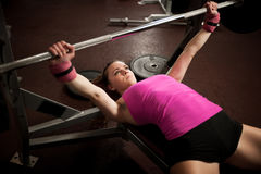 Woman workout in fitness gym with barbells - powerlift workout Royalty Free Stock Photo