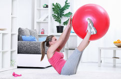Woman workout fitness posture abdominals. Push-ups with fitness ball Royalty Free Stock Images