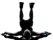 Woman workout fitness posture abdominals push ups. One woman exercising workout fitness aerobic exercise abdominals push ups posture on studio isolated white stock image