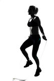Woman workout fitness posture jumping rope. Woman workout fitness posture body building jumping rope exercise exercising on studio isolated white background Stock Photography