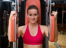 Woman workout in gym Royalty Free Stock Photography